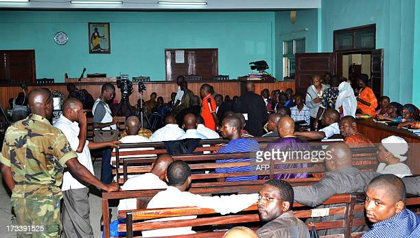 Defendants charged with a failed assassination attempt on President Alpha Conde wait on July 13 2013 in court in Conakry Two ringleaders received...