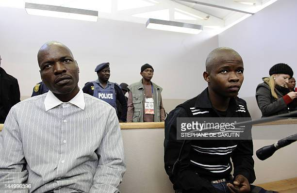 Defendants Chris Mahlungu and an 18yearold youth sit on May 22 2012 in the dock before the verdict in the murder trial of white supremacist Afrikaner...
