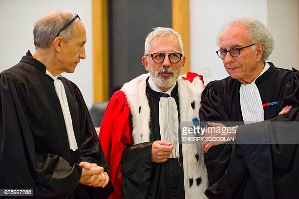 Defendant's French lawyer Mohamed Khanifar public prosecutor Raphael Sanesi and defendant's French lawyers GillesJean Portejoie are pictured on the...