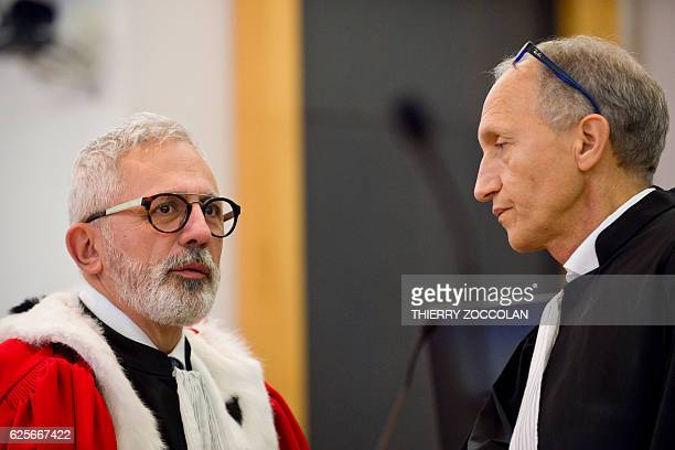 Defendant's French lawyer Mohamed Khanifar speaks with public prosecutor Raphael Sanesi on the 10th day of the trial of Cecile Bourgeon and Berkane...