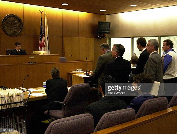 Defendants, Jorg Halaby, Brockovich's ex-boyfriend, from left behind counsel, John Reiner, and Shawn Brown, Brockovich's ex-husband, appear before...