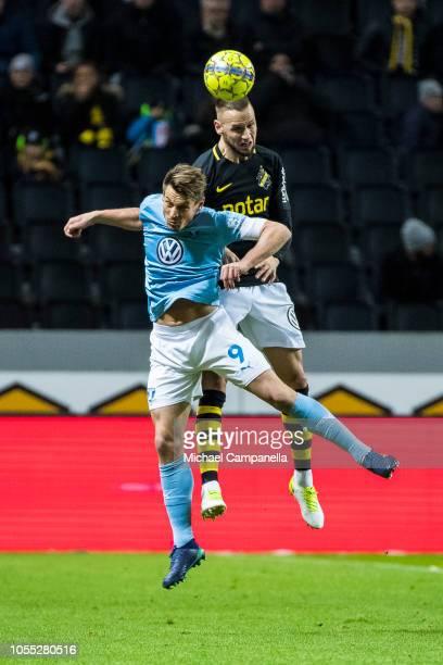 AIK defender Alexander Milosevic wins an arial duel against Malmo FF forward Markus Rosenberg during an Allsvenskan match between AIK and Malmo FF at...