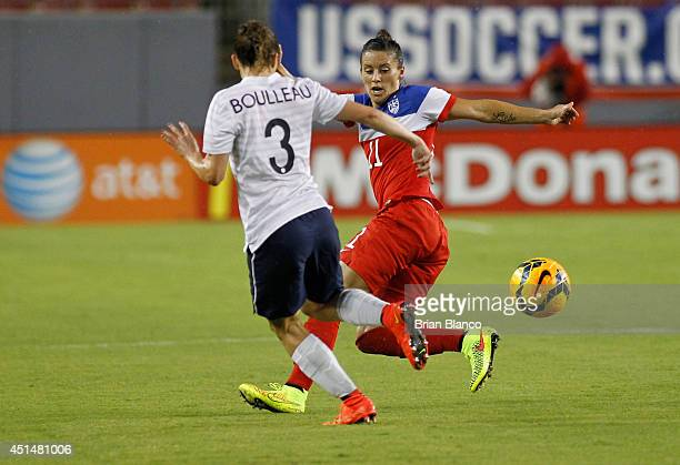 Defender Ali Krieger of the United States battles for the ball against defender Laure Boulleau of France during the first half of a women's friendly...