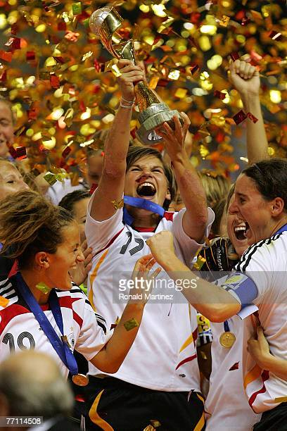 Defender Ariane Hingst of Germany raises the FIFA Women's World Cup 2007 trophy after defeating Brazil 20 at Shanghai Hongkou Football Stadium on...