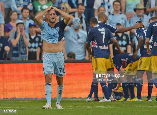Defender Aurelien Collin of Sporting Kansas City reacts after giving up a goal to the New York Red Bulls during the second half on August 3 2013 at...