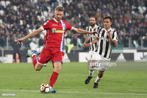 SPAL defender Bartosz Salamon in action against Juventus forward Paulo Dybala during the Serie A football match n10 JUVENTUS SPAL on at the Allianz...