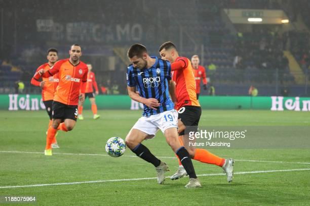 Defender Berat Djimsiti of Atalanta B.C. And forward Junior Moraes of FC Shakhtar Donetsk are seen in action during the UEFA Champions League...