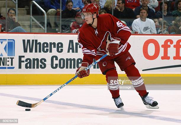 Defender Brad Ference of the Phoenix Coyotes and center David Legwand of the Nashville Predators chase the puck during the game at Glendale Arena on...