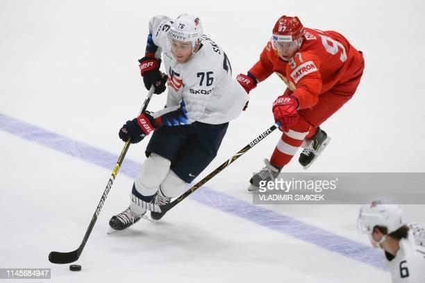 TOPSHOT US' defender Brady Skjei and Russia's forward Ivan Telegin vie for the puck during the IIHF Men's Ice Hockey World Championships quarterfinal...