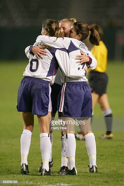 Defender Brandi Chastain of the USA celebrates with her teammates midfielder Aly Wagner and forward Mia Hamm during the Fan Celebration Tour finale...