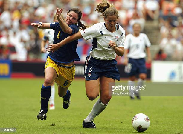 Defender Cat Reddick of the United States fends offs midfielder Malin Mostroem of Sweden during the 2003 FIFA Women's World Cup first round Group A...