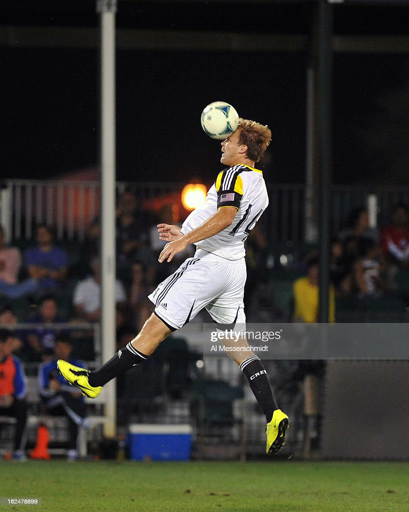 Defender Chad Marshall #14 of the Columbus Crew jumps for a ball against the Montreal Impact in the final round of the Disney Pro Soccer Classic on February 23, 2013 at the ESPN Wide World of Sports Complex in Orlando, Florida.