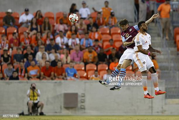 Defender Chris Herd of Aston Villa and forward Giles Barnes of the Houston Dynamo go up for a header during the BBVA Compass Dynamo Charities Cup...