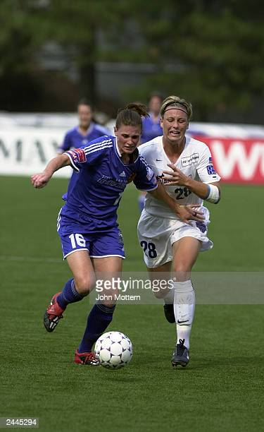 Defender Christine McCann of the Boston Breakers and forward Abby Wambach of the Washington Freedom battle for the ball during the WUSA Semifinals at...