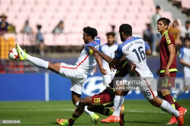 US defender Erik PalmerBrown reaches for the ball ahead of Venezuela's forward Sergio Cordova as US defender Cameron CarterVickers and Venezuela's...
