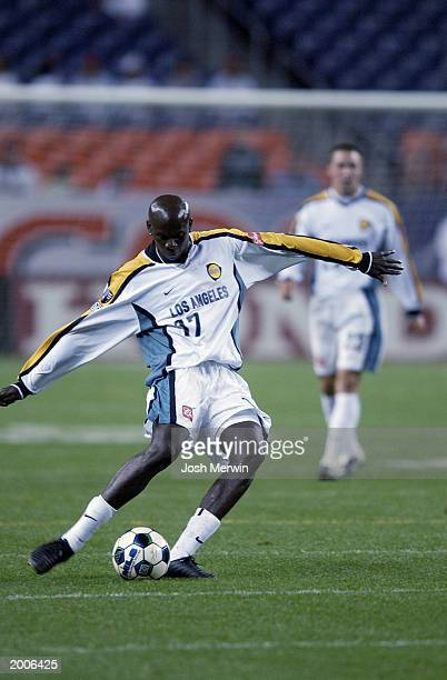 Defender Ezra Hendrickson of the Los Angeles Galaxy dribbles the ball against the Colorado Rapids in game 2 of the MLS semifinals at INVESCO Field at...