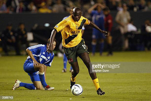Defender Ezra Hendrickson of the Los Angeles Galaxy dribbles the ball against the Kansas City Wizards during the Major League Soccer game at the Home...
