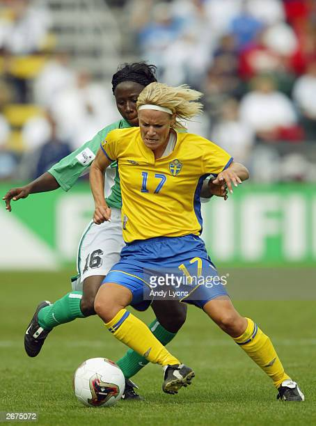Defender Florence Iweta of Nigeria pressures midfielder Anna Sjoestroem of Sweden during the 2003 FIFA Women's World Cup at Crew Stadium on September...