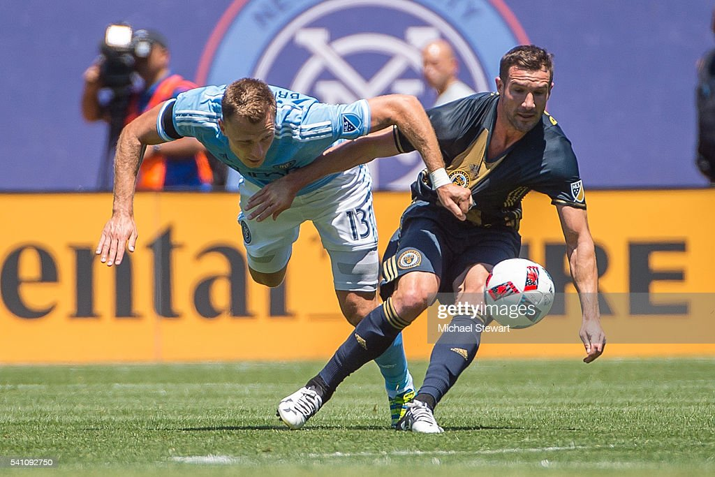 Defender Frederic Brillant #13 of New York City FC and midfielder Chris Pontius #13 of Philadelphia Union vie for the ball during the match at Yankee Stadium on June 18, 2016 in New York City. New York City FC defeats Philadelphia Union 3-2.