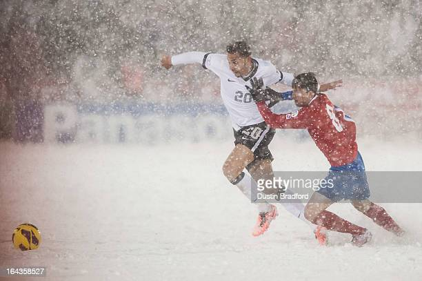 Defender Geoff Cameron of the United States battles defender Bryan Oviedo of Costa Rica during a FIFA 2014 World Cup Qualifier match between Costa...