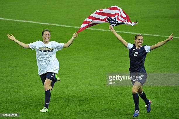 US defender Heather Mitts and defender Kelley O'Hara celebrate with the US national flag after the final of the women's football competition of the...