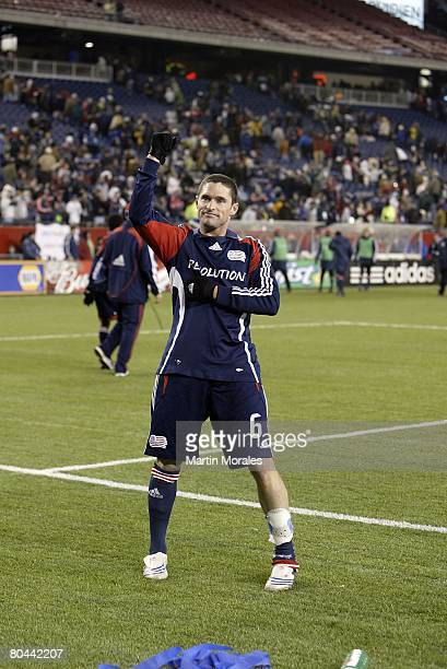 Defender Jay Heaps of the New England Revolution salutes the fans after the victory against the Houston Dynamo in the season opening game on March 29...