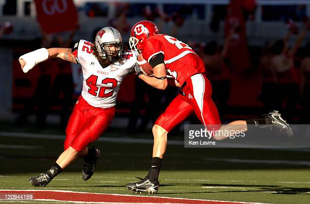 Defender Jay Staggs gets set to tackle Utah receiver Brandon Godfrey after a 21 yard pass play in the fourth quarterat Rice-Eccles Stadium, in Salt...