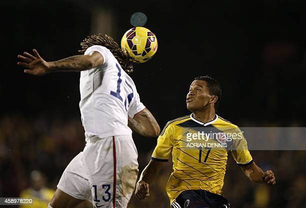 US defender Jermaine Jones jumps to head the ball under pressure from Colombia's striker Carlos Bacca during the friendly international football...
