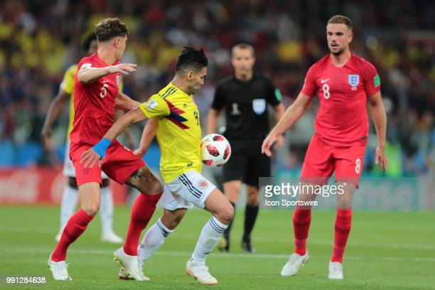 defender John Stones of England and forward Radamel Falcao of Colombia during the Round of 16 2018 FIFA World Cup soccer match between Colombia and...