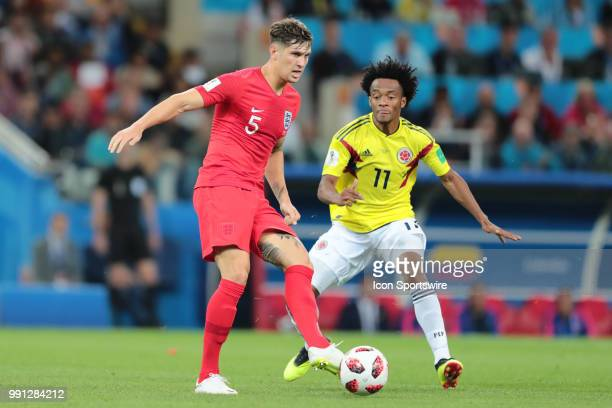 defender John Stones of England and midfielder Juan Cuadrado of Colombia during the Round of 16 2018 FIFA World Cup soccer match between Colombia and...