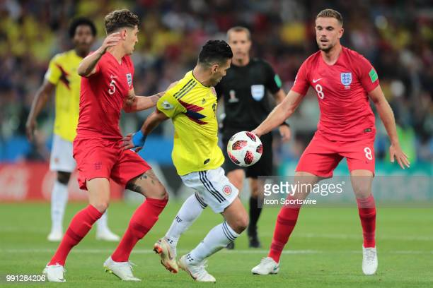defender John Stones of England National team forward Radamel Falcao of Colombia and midfielder Jordan Henderson of England during the Round of 16...