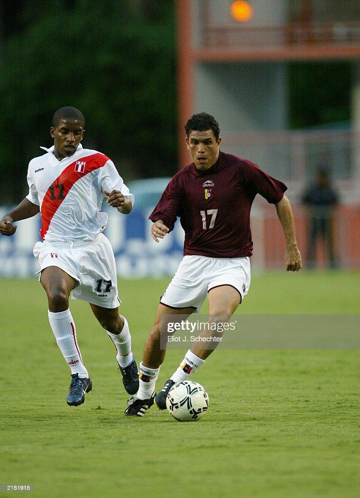 Rojas drives the ball past Farfan  : News Photo