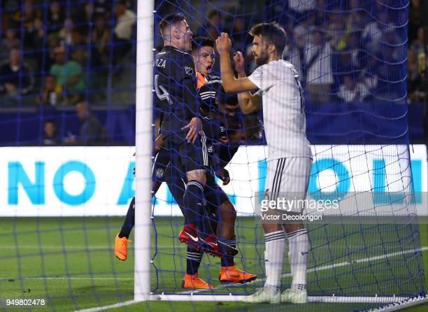 Defender Jorgen Skjelvik of Los Angeles Galaxy looks on as Miguel Almiron of Atlanta United jumps on teammate Josef Martinez after Martinez scored...
