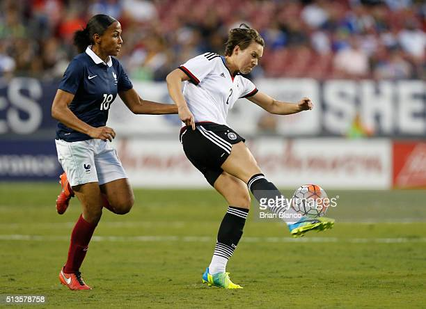 Defender Josephine Henning of Germany controls the ball ahead forward MarieLaure Delie of France during the second half of the 2016 SheBelieves Cup...