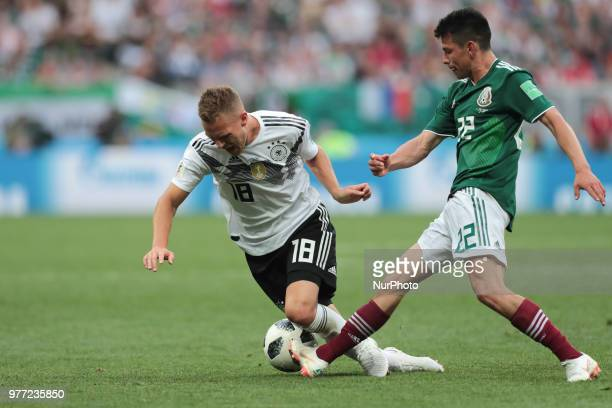 defender Joshua Kimmich of Germany National team and forward Hirving Lozano of Mexico National team during the group F match between Germany and...