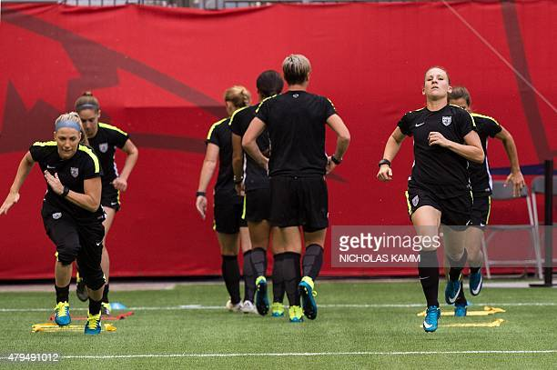 US defender Julie Johnston and midfielder Amy Rodriguez take part in a training session in Vancouver British Columbia on July 4 on the eve of the...