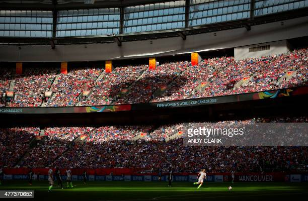 USA defender Julie Johnston chases the ball through a beam of sunlight during a Group C football match between Nigeria and USA at BC Place Stadium in...