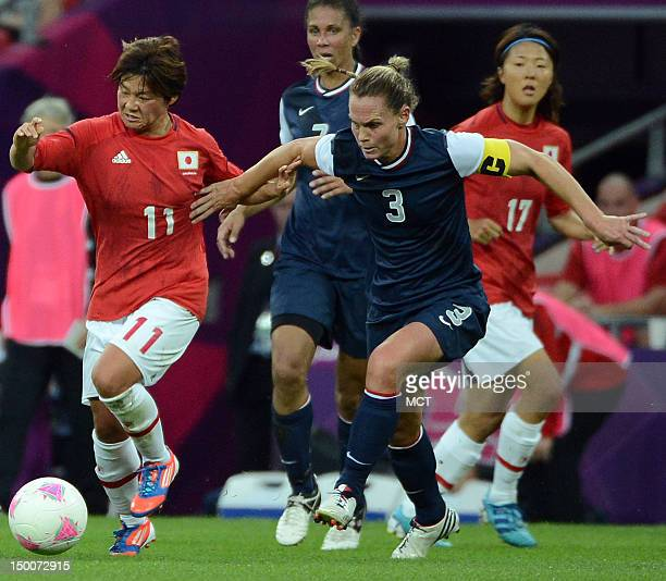 USA defender Kelley O'Hara battles for the ball with Japan Shinobu Ohno during the first half of the Olympics women's soccer final at Wembley Stadium...
