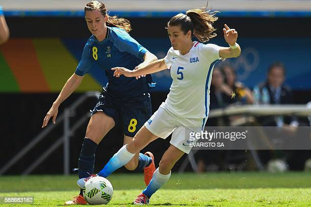 US defender Kelley O'Hara vies for the ball with Sweden forward Lotta Schelin during the Rio 2016 Olympic Games Quarterfinals women's football match...