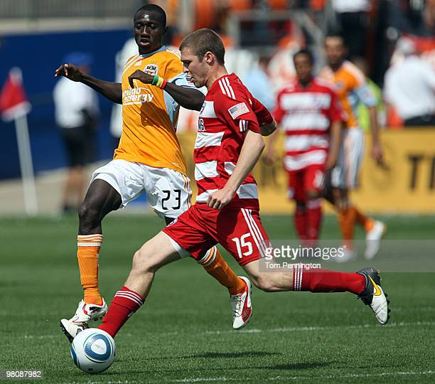 Defender Kyle Davies of FC Dallas moves the ball against forward Dominic Oduro of the Houston Dynamo during a MLS game at Pizza Hut Park on March 27...
