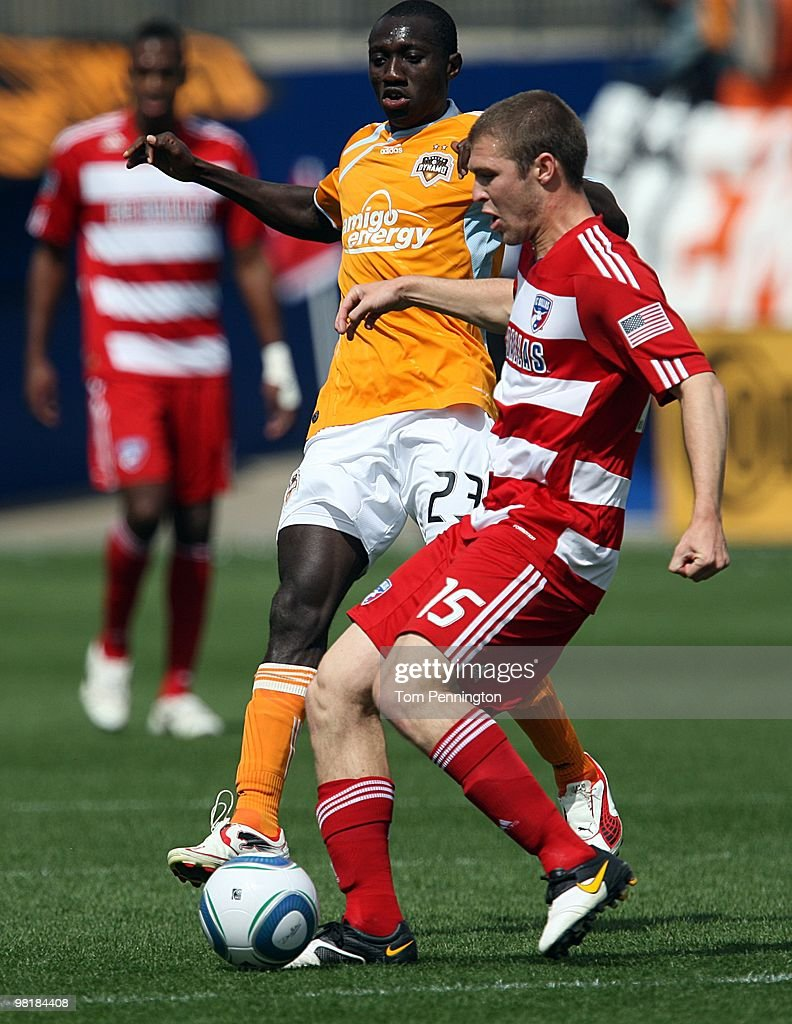 Defender Kyle Davies #15 of FC Dallas moves the ball against forward Dominic Oduro #23 of the Houston Dynamo during a MLS game at Pizza Hut Park on March 27, 2010 in Frisco, Texas.