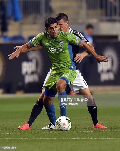 Defender Leo Gonzalez of the Seattle Sounders FC controls the ball in front of forward Sebastien Le Toux of the Philadelphia Union during the 2014 US...