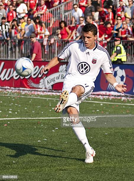 Defender Marc Burch of DC United kicks the ball during the match against the Toronto FC at BMO Field on August 15 2009 in Toronto Canada Toronto won...