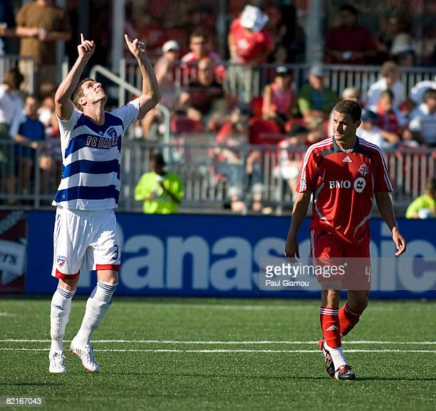 Defender Marco Velez of Toronto FC watches as forward Kenny Cooper of FC Dallas celebrates his second goal of the match on August 3 2008 at BMO Field...