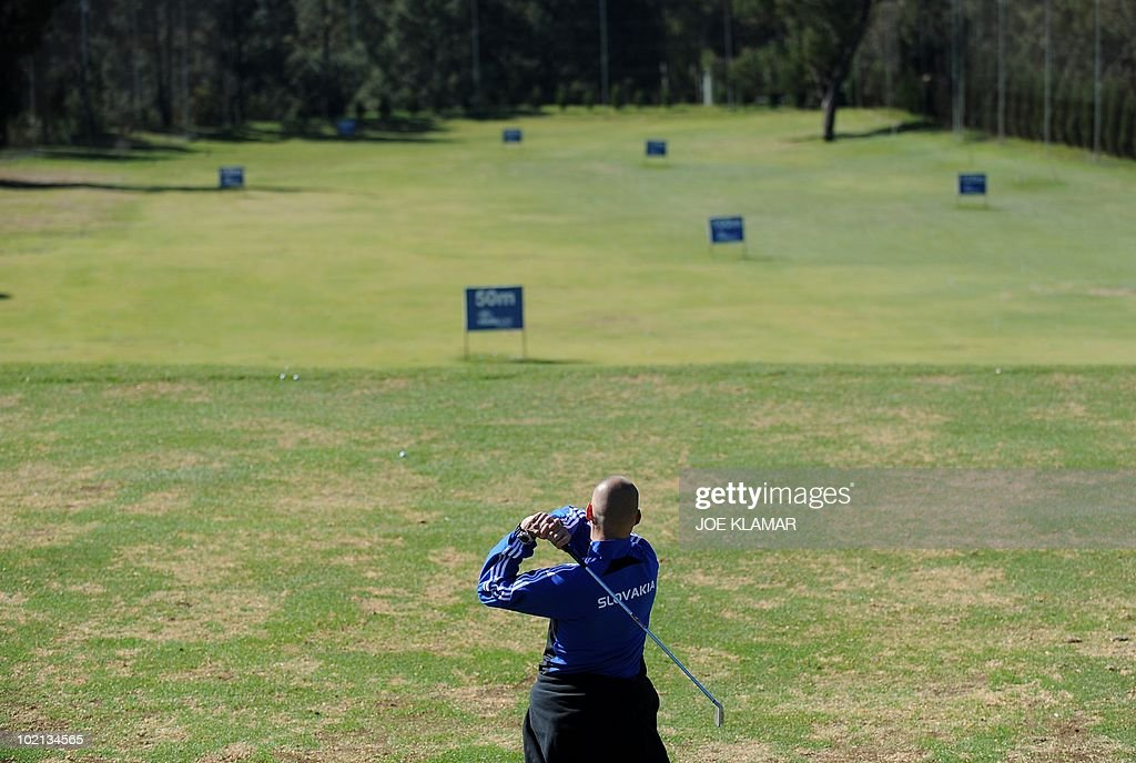 Defender Martin Skrtel of Slovakia's national football team tees off at a golf practice range at Pretoria Coutry Club on June 16, 2010 during the 2010 World Cup football tournament in South Africa.