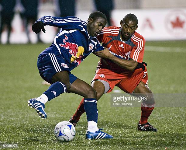 Defender Marvell Wynne of the Toronto FC pulls forward Jozy Altidore of the New York Red Bulls during their game at BMO Field May 1, 2008 in Toronto,...