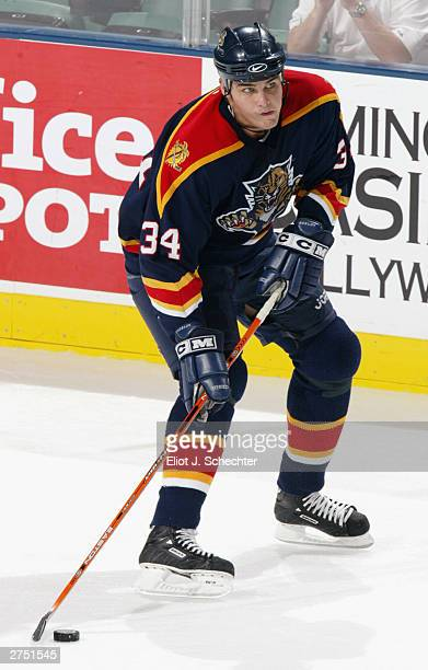 Defender Mathieu Biron of the Florida Panthers looks to make a play against the Carolina Hurricanes on October 9, 2003 at the Office Depot Center in...