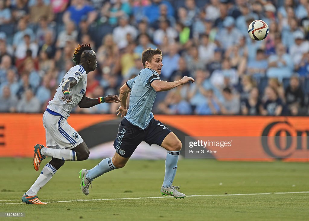 Defender Matt Besler #5 of Sporting Kansas City runs after a loose ball against forward Dominic Oduro #7 of the Montreal Impact during the first half on July 18, 2015 at Sporting Park in Kansas City, Kansas.