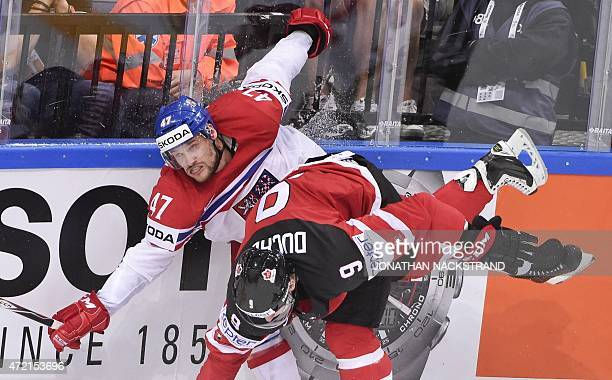Defender Michal Jordan of Czech Republic gets hit by forward Matt Duchene of Canada during the group A preliminary round ice hockey match Canada vs...