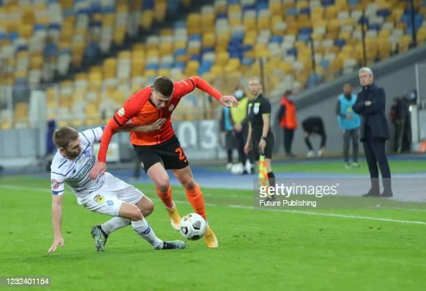 Defender Mykola Matviyenko of FC Shakhtar Donetsk and defender Oleksandr Karavaev of FC Dynamo Kyiv are seen in action during the Ukrainian Premier...